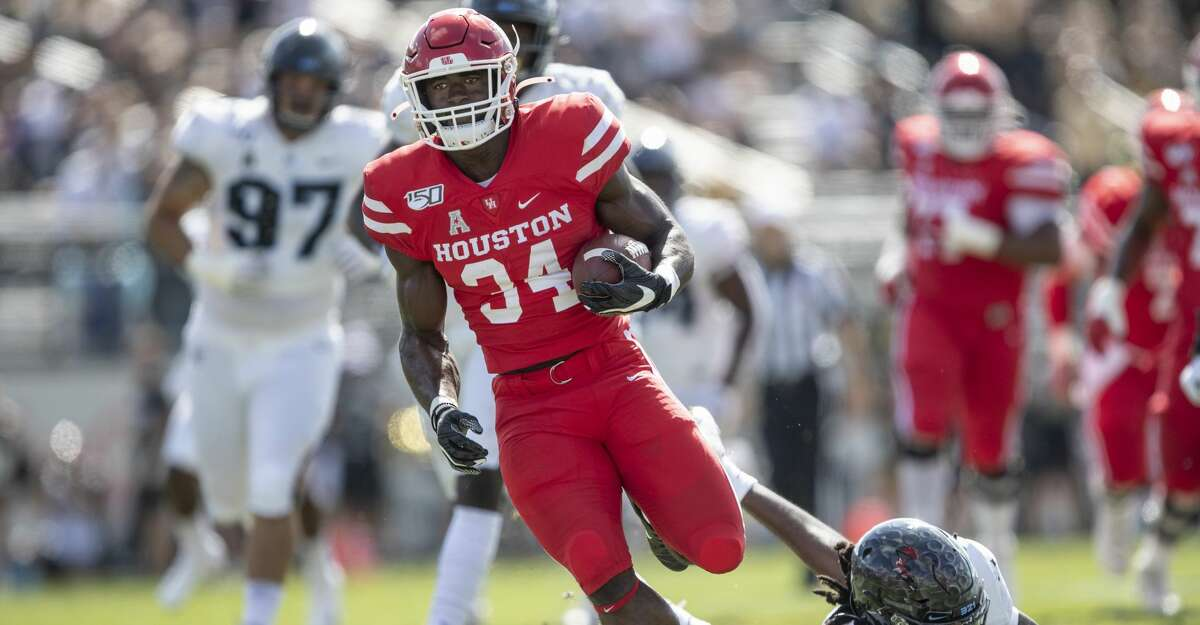 Houston running back Mulbah Car (34) runs runs by Central Florida defensive back Antwan Collier (3) during the first half of an NCAA college football game in Orlando, Fla., Saturday, Nov. 2, 2019. (Photo/Willie J. Allen Jr.)