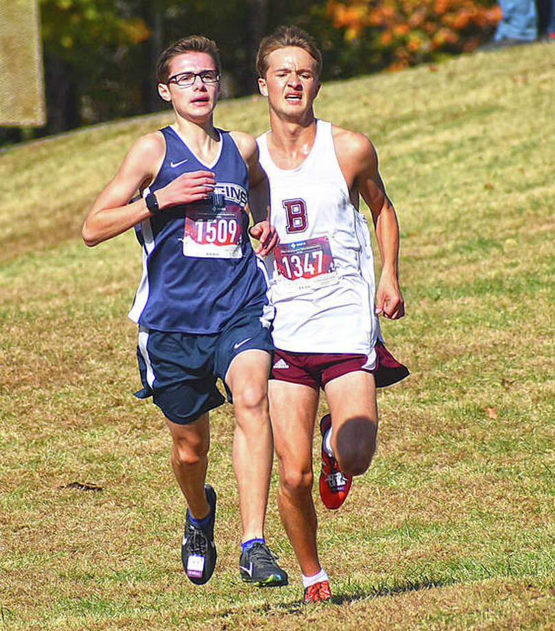 Father McGivney's Brandon Ahring, front, tries to stay ahead of Benton's Brady Gischer on the downhill run to the finish line at the Class 1A Benton Sectional on Saturday. Photo: Matt Kamp|The Intelligencer