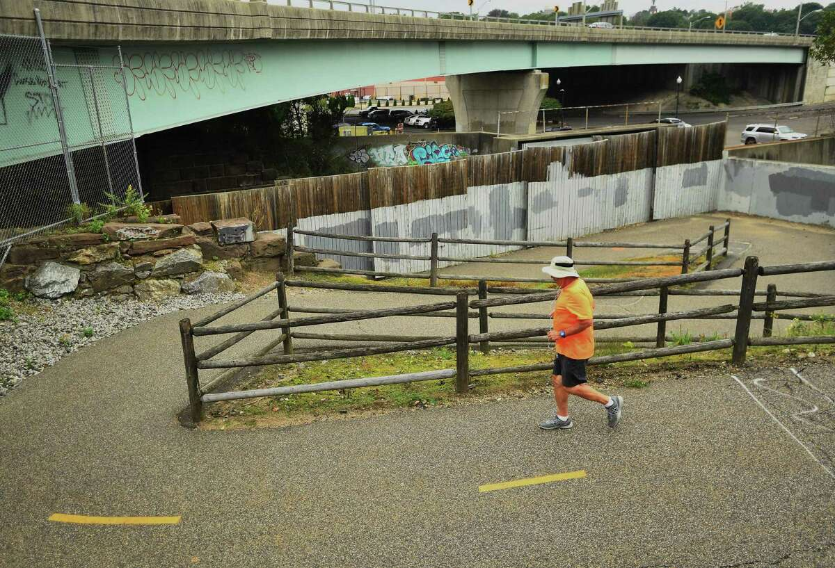 FILE PHOTO of a jogger on the Naugatuck River Greenway in Derby, Conn. on Thursday, September 12, 2019.