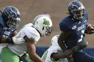Rice quarterback JoVoni Johnson, right, is tackled by Marshall safety Nazeeh Johnson during the second half of an NCAA college football game, Saturday, Nov. 2, 2019, in Houston.