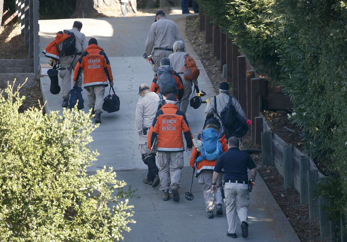 Members of the Contra Costa County Search and Rescue team walk towards a home on Lucille Way in Orinda, Calif. on Friday, Nov. 1, 2019 after a shooting during a Halloween party.