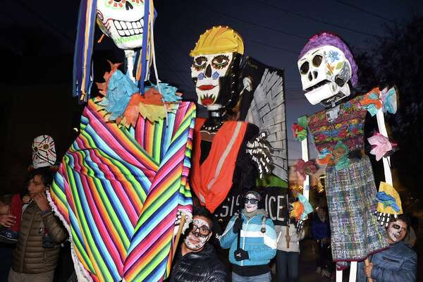 A parade during the Day of the Dead Festival sponsored by Unidad Latina en Accion travels up Saltonstall Avenue in New Haven on November 2, 2019.