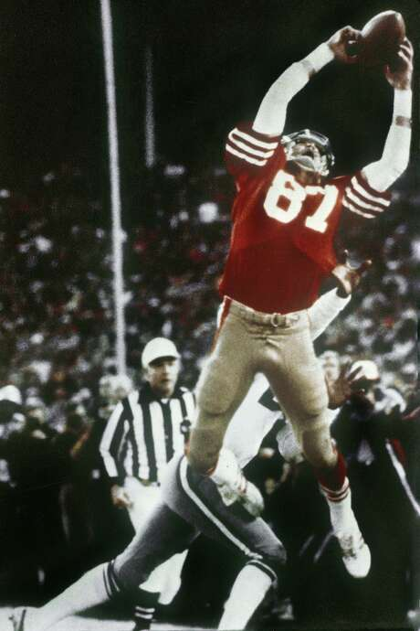 "San Francisco 49ers wide receiver Dwight Clark makes ""The Catch"" from a desperation heave by Joe Montana that tied the game late in the fourth quarter against the Dallas Cowboys in the NFC championship football game at Candlestick Park. Photo: Phil Huber / Associated Press 1982"