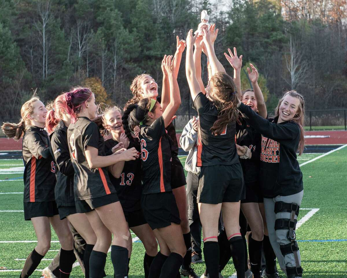The Bethlehem girls soccer team hoists its mascot after beating Niskayuna for the Section II, Class AA championship at Mechanicville High School on Saturday, Nov. 1, 2019 (Jim Franco/Special to the Times Union.)