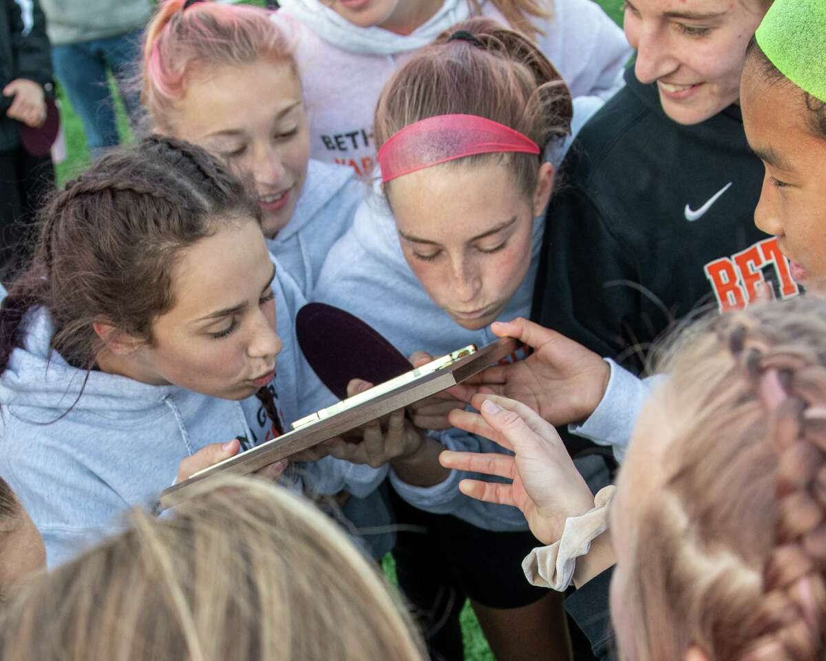 Bethlehem girls soccer players take turns kissing the Section II, Class AA championship plaque after beating Niskayuna at Mechanicville High School on Saturday, Nov. 1, 2019 (Jim Franco/Special to the Times Union.)