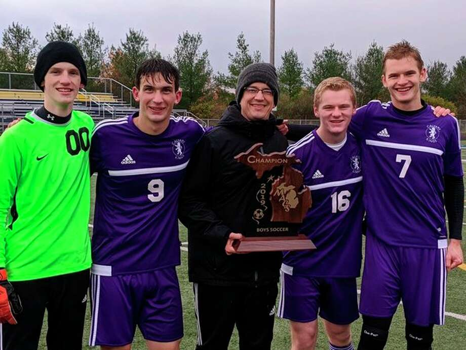 Pictured, from left, are Calvary Baptist senior soccer players Jude Tenbusch, Joshua Kipfmiller, head coach James Day, Noah Haines and Nathan Bright.