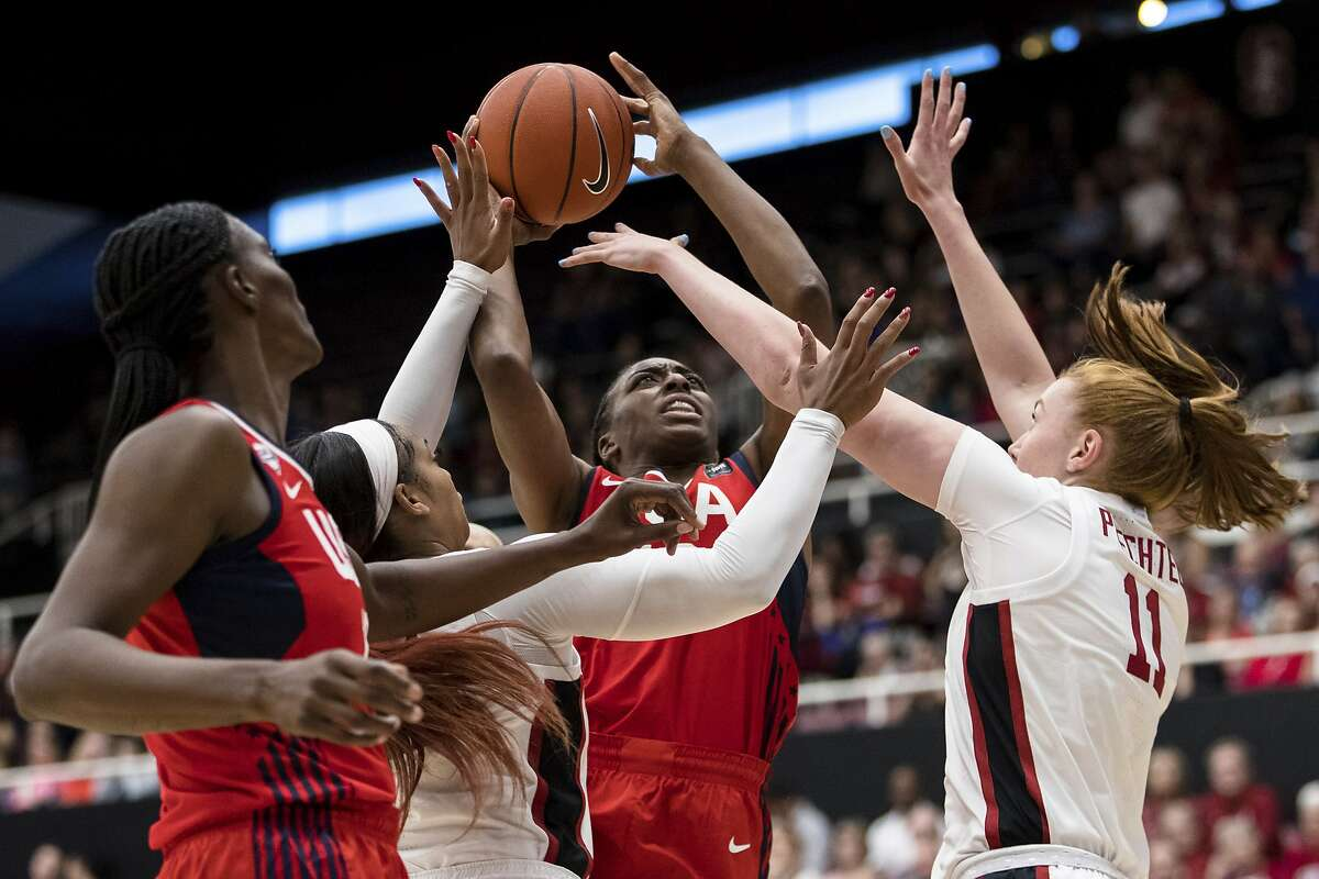 U.S. forward Nneka Ogwumike (16) shoots as Stanford forward Ashten Prechtel, right, and Stanford guard Kiana Williams, left, defend in the second quarter of an exhibition women's basketball game, Saturday, Nov. 2, 2019, in Stanford, Calif. (AP Photo/John Hefti)