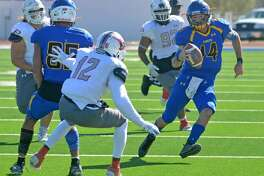 Wayland Baptist quarterback Mitchell Parsley scrambles up the field for yardage while receiver Brayln Kirby tries to shield Oklahoma Panhandle State's Malik Brown during their Sooner Athletic Conference football game on Saturday in Greg Sherwood Memorial Bulldog Stadium.