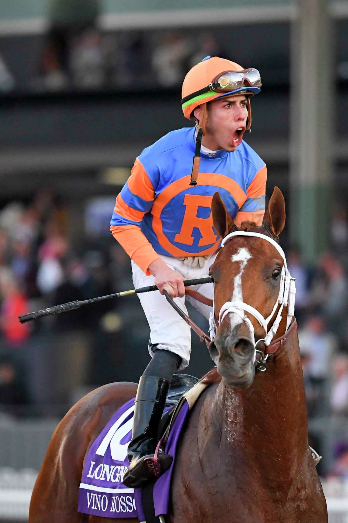 Irad Ortiz Jr. celebrates after riding Vino Rosso to victory in the Breeders' Cup Classic horse race at Santa Anita Park, Saturday, Nov. 2, 2019, in Arcadia, Calif.