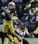 Notre Dame defensive back Kyle Hamilton (14) intercepts a pass intended for Virginia Tech wide receiver Hezekiah Grimsley (6) during the second half of an NCAA college football game, Saturday, Nov. 2, 2019, in South Bend, Ind. (AP Photo/Carlos Osorio)