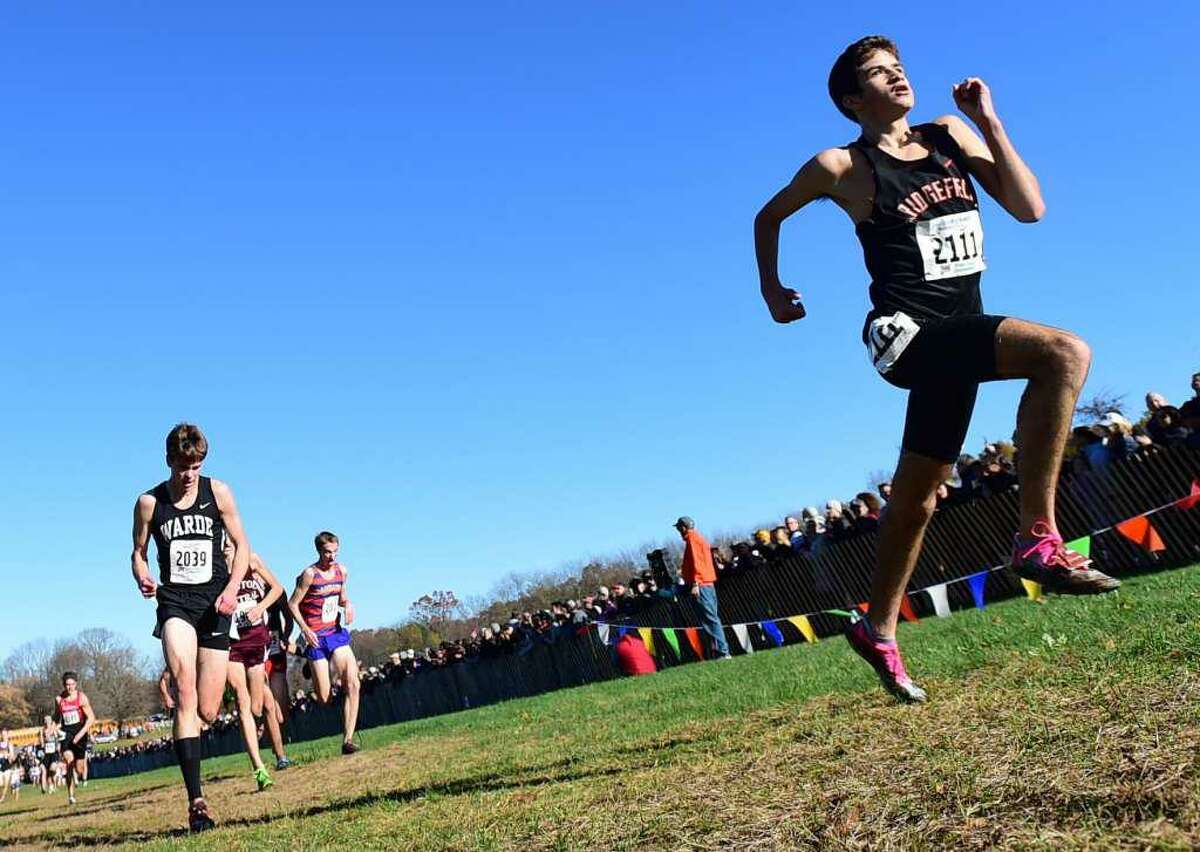Ridgefield's Chuckie Namiot heads to the finish line at Friday's State Open boys cross country championship.