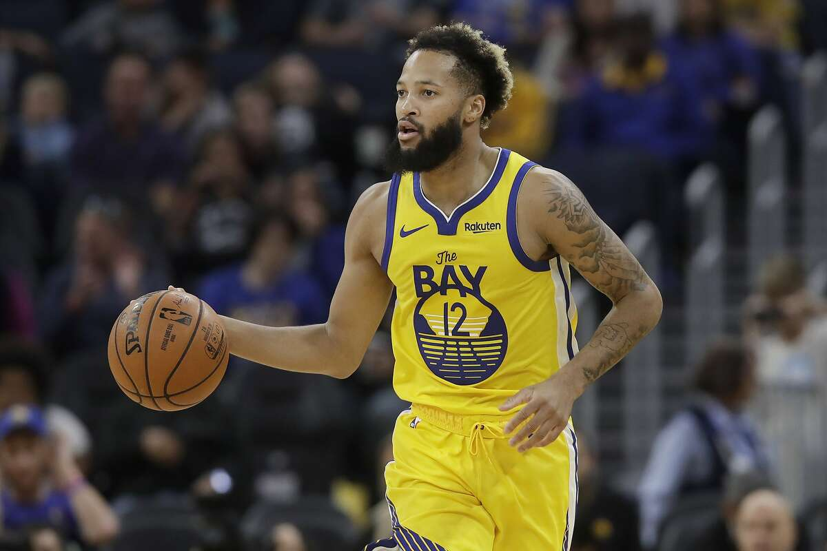 Golden State Warriors guard Ky Bowman (12) dribbles up court against the Charlotte Hornets during the second half of an NBA basketball game in San Francisco, Saturday, Nov. 2, 2019. (AP Photo/Jeff Chiu)