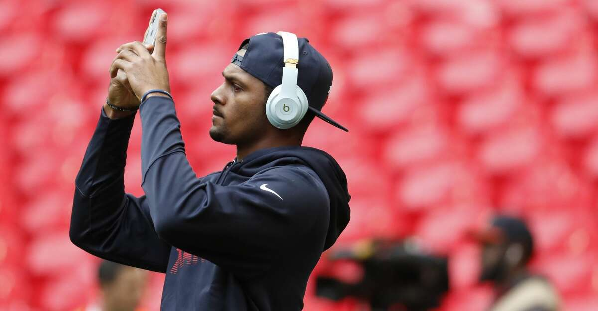 Houston Texans quarterback Deshaun Watson takes a photo with his phone before an NFL football game against the Jacksonville Jaguars at Wembley Stadium on Sunday, Nov. 3, 2019, in London.