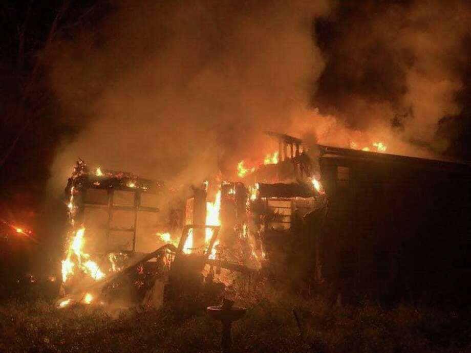 Fire crews battled a blaze that consumed a Ravenwood Road home Saturday, Nov. 2. The fire left one man displaced, but nobody was home when it occurred, officials said. Photo: Contributed /Norwalk Fire Department