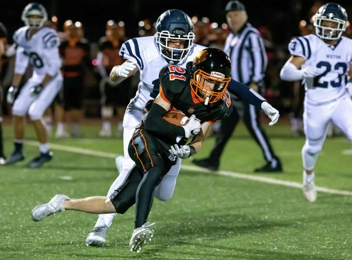 Owen Gaydos (shown in a game earlier this season) scored three touchdowns as Ridgefield routed Stamford, 56-12, on Friday, Nov. 1, in Ridgefield.