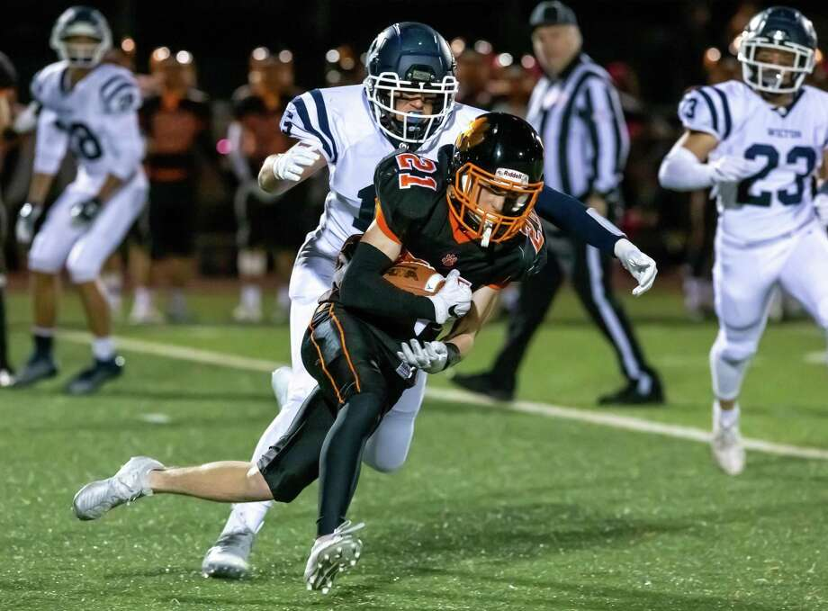 Owen Gaydos (shown in a game earlier this season) scored three touchdowns as Ridgefield routed Stamford, 56-12, on Friday, Nov. 1, in Ridgefield. Photo: Gretchen McMahon / For Hearst Connecticut Media
