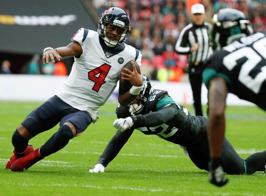 Texans quarterback Deshaun Watson (4) slides for a first down as he's chased down by Jaguars linebacker Najee Goode during the second quarter Sunday in London. Photo: Brett Coomer, Staff Photographer / © 2019 Houston Chronicle