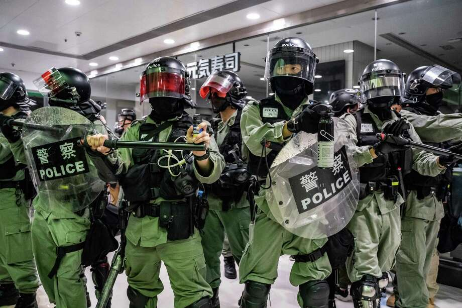 Riot police secure an area after detaining protesters in a shopping mall during a protest rally in Hong Kong. Riot officers stormed several malls across the city to thwart protesters. Photo: Anthony Kwan / Getty Images / 2019 Getty Images