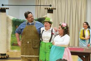 """Left to right, first-year graduate students Evan Babel, tenor, as woodworker/clock-maker Geppetto, Stephanie Mossinghof, mezzo soprano, as Pinocchio, and SIUE student Cady Thomas, as Olympia, perform in a dress rehearsal of """"Pinocchio: An Opera for Kids."""""""