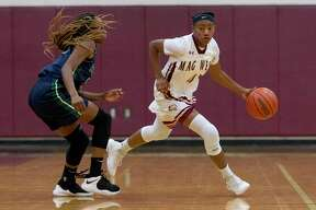 Magnolia West point guard Kamari Portalis (4), shown here last season, scored 18 points over two games played on Thursday at the Peggy Whitley Classic.
