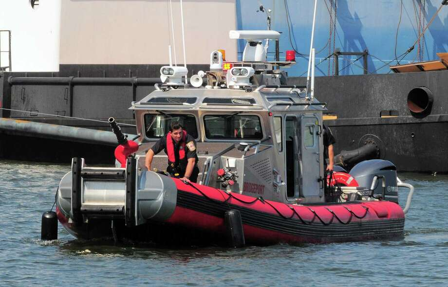 Bridgeport Fire Department's fire boat on patrol in Bridgeport Harbor in Bridgeport, Conn. on Friday June 30, 2017. The fire department's boat as well as Bridgeport Police boats will be on duty throughout the holiday weekend. Photo: Christian Abraham / Hearst Connecticut Media / Connecticut Post