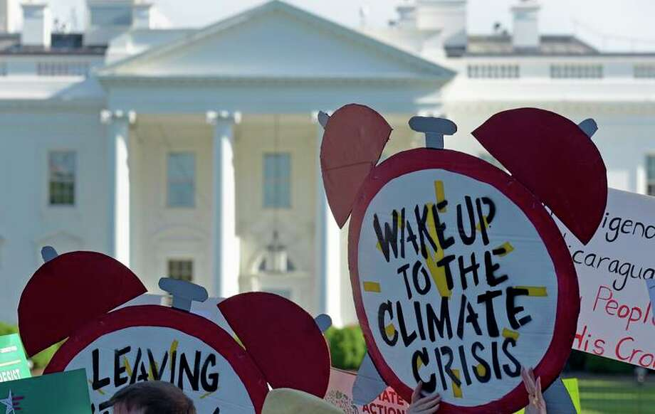 Protesters rally outside the White House in 2017 against President Trump's climate policies. Photo: Susan Walsh / Associated Press 2017 / Copyright 2017 The Associated Press. All rights reserved.