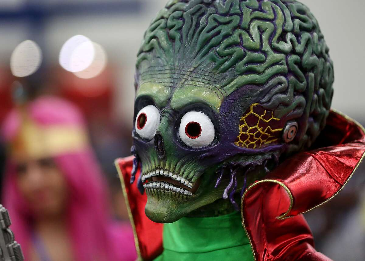 """Haley Elliott, dressed as an alien from """"Mars Attacks,"""" poses for a photo at Comicpalooza, at the George R. Brown Convention Center, Saturday, June 18, 2016, in Houston. ( Jon Shapley / Houston Chronicle )"""
