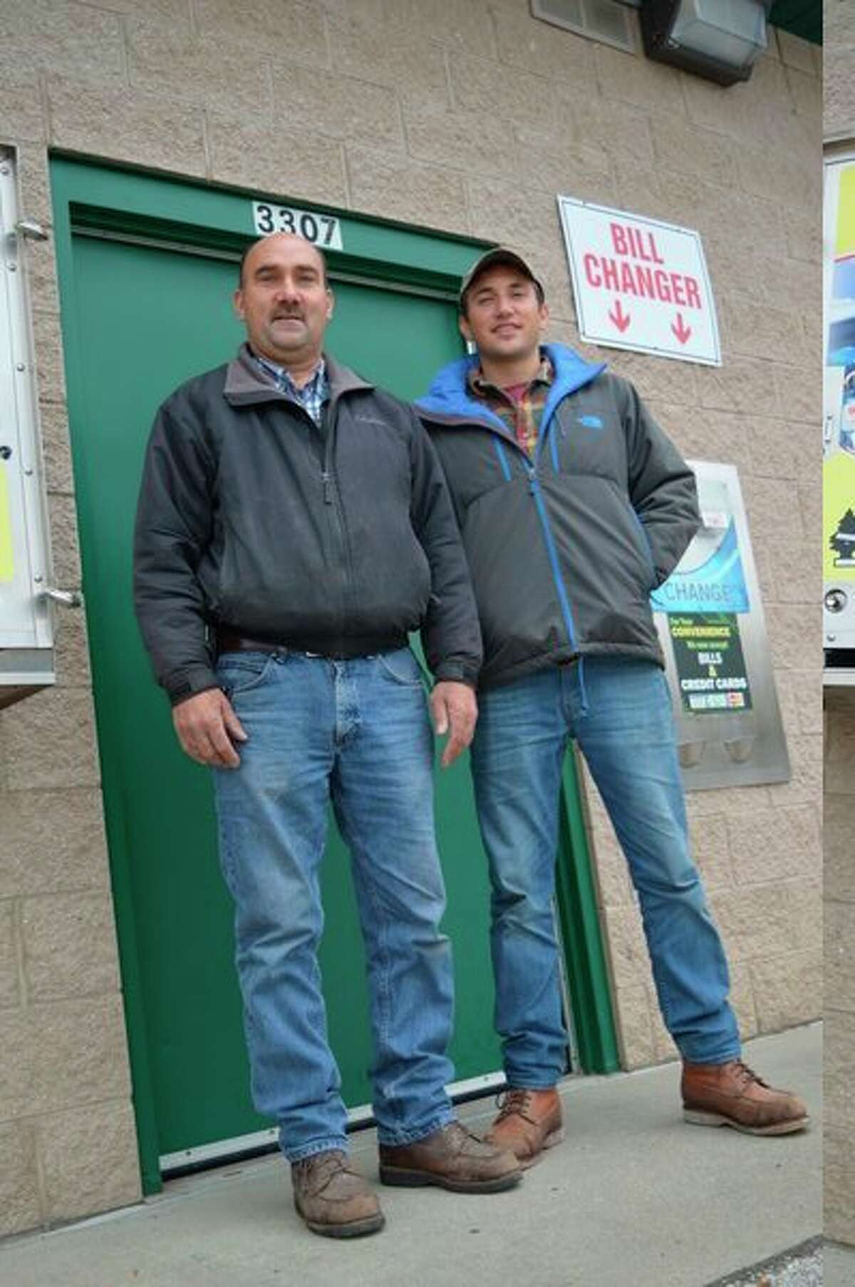 Randy Weiss and his son, Ryan stand outside of Splash-N-Dash Car Wash, located at 3307 Bay City Road in Midland. (Photo by Emily Davis)