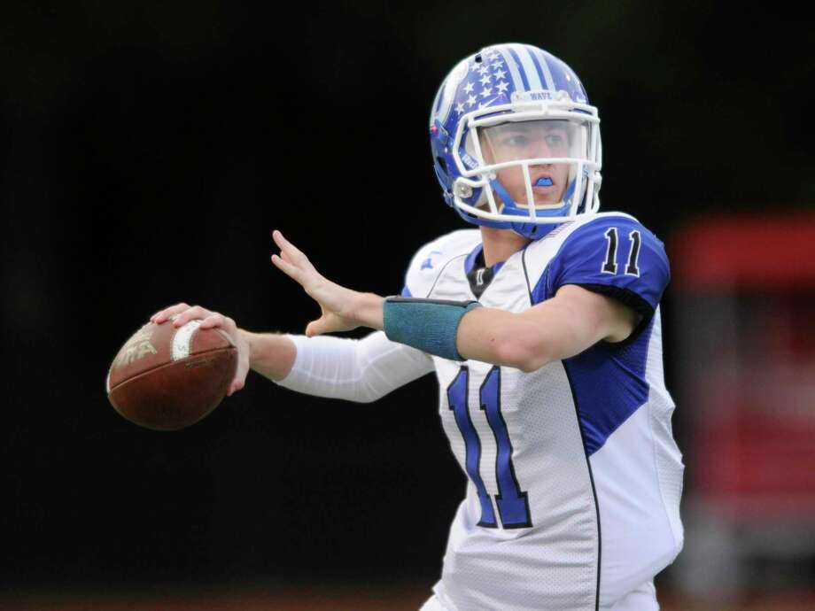 Darien QB Peter Grahm throws a pass during the Wave's win over Greenwich on Oct. 26. Graham connected with Jackson Peters for a 69-yard touchdown pass in the fourth quarter as Darien defeated Danbury 26-23 on Saturday, Nov. 2. Photo: Matthew Brown / Hearst Connecticut Media / Stamford Advocate