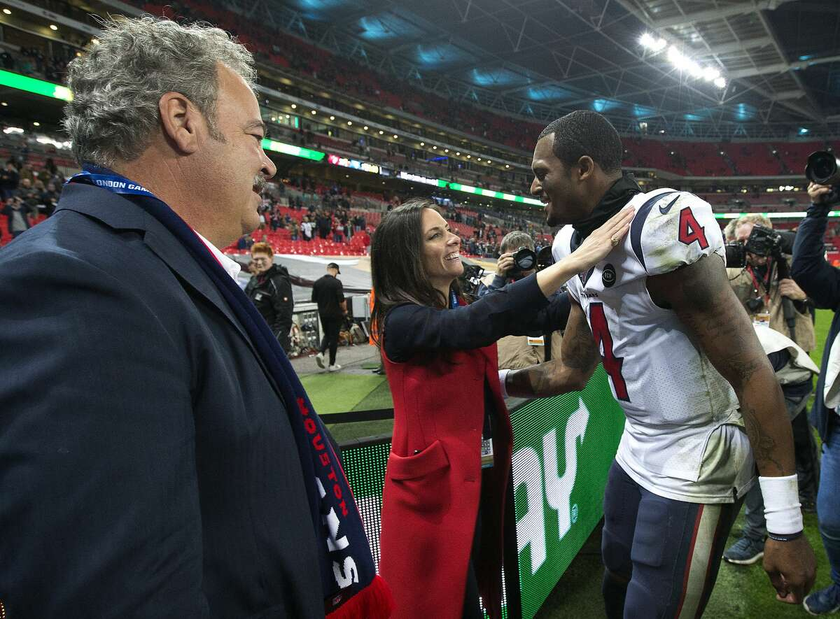 Houston Texans quarterback Deshaun Watson (4) embraces Hannah McNair as he celebrates the Texans 26-3 win over the Jacksonville Jaguars at Wembley Stadium on Sunday, Nov. 3, 2019, in London.