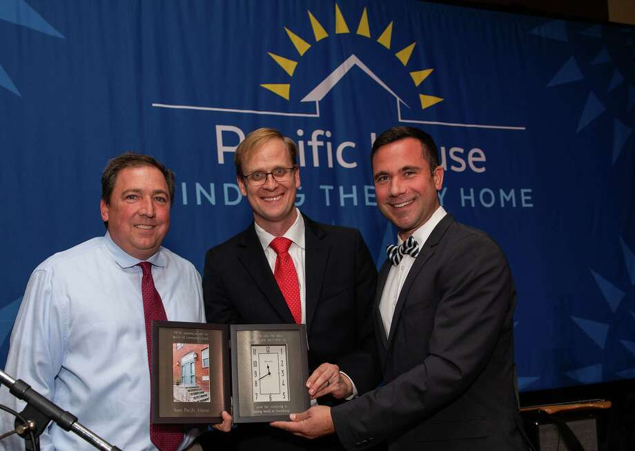 Round Hill Community Church of Greenwich is honored with the Pacific House Community Award at the gala at they Hyatt Regency Greenwich. From left: church member and volunteer Roland Kistler, Pacific House Board Chair Chris Tate and the Rev. Dan Haugh Photo: Contributed / Jenna Bascom Stamford Magazine /Moffly Media /