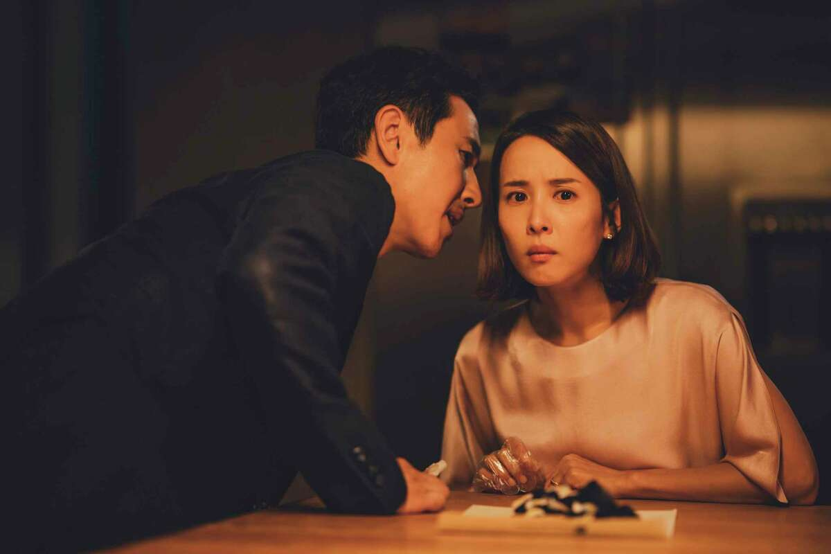 This image released by Neon shows Sun-kyun Lee, left, and Yeo-jeong Jo in a scene from