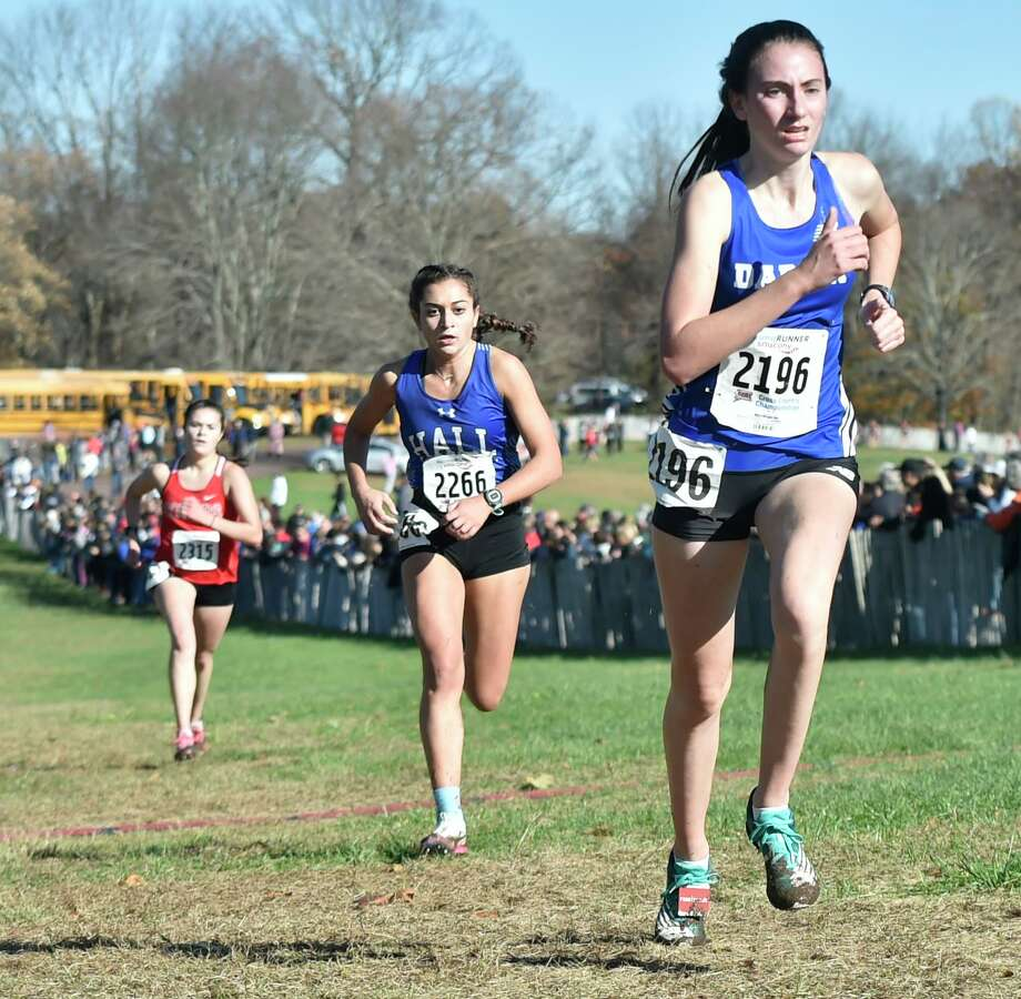 Manchester, Connecticut -Wednesday, November 1, 2019: The CIAC Girls Cross Country Open Championship Friday at Wickham Park in Manchester: 12th place finisher Kylie Raymond of Somers H.S., left, 11th place finisher Jenna Zydanowicz of Hall H.S., center, and 10th place finisher Mairead Clas of Darien, right, Photo: Peter Hvizdak / Hearst Connecticut Media / New Haven Register