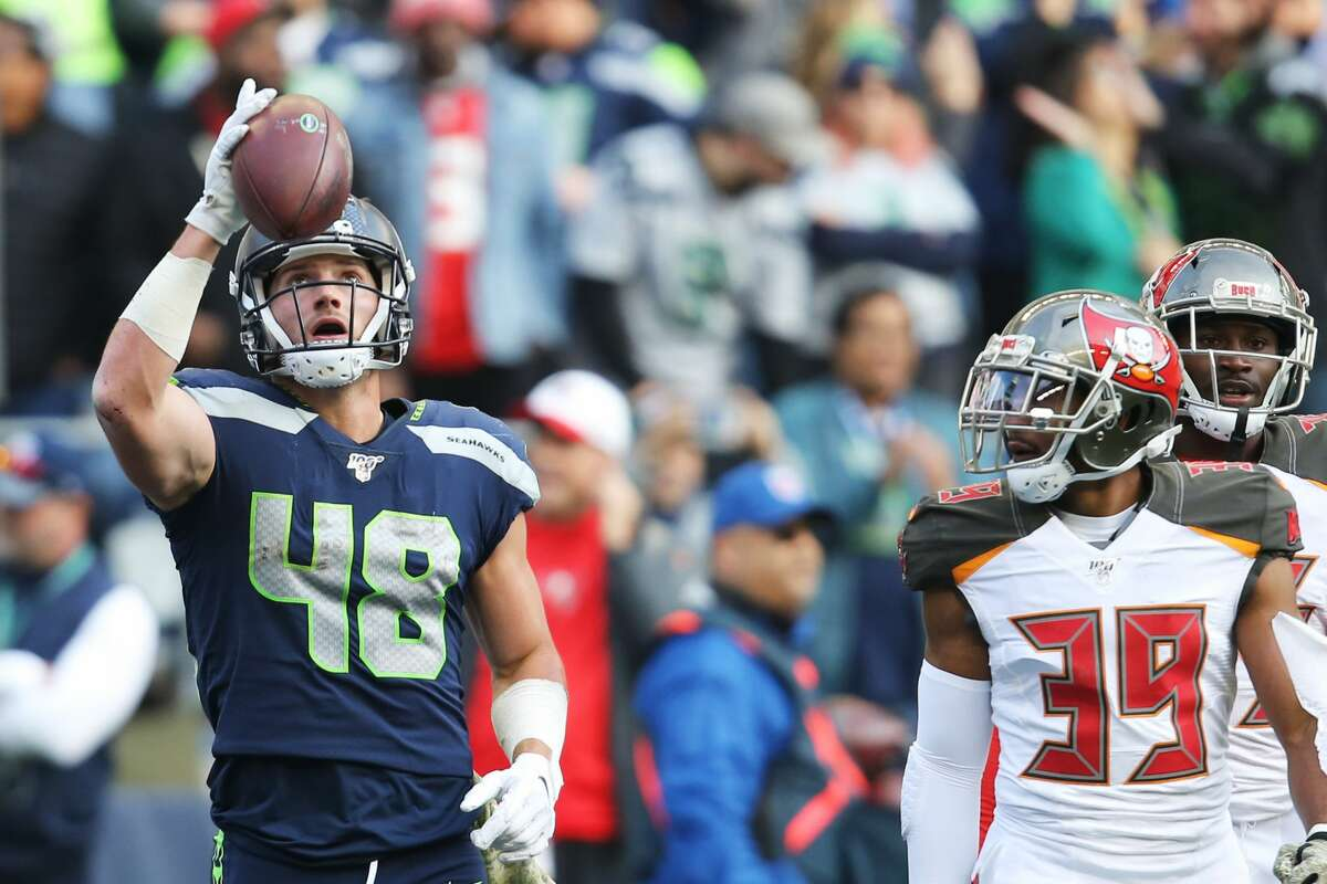 Seattle Seahawks tight end Jacob Hollister (48) celebrates a touchdown in the second quarter of Seattle's game against Tampa Bay, Sunday, Nov. 3, 2019 at CenturyLink Field