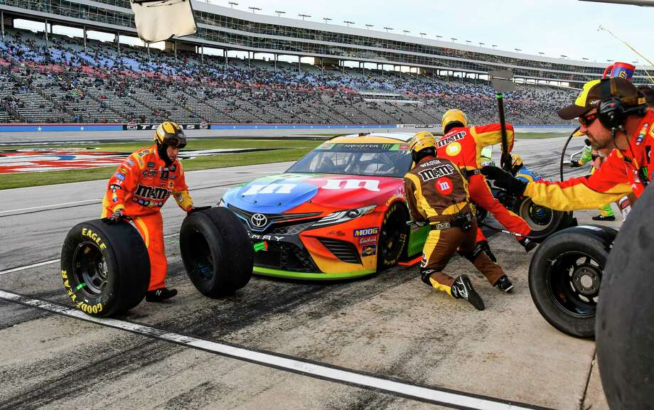 Kyle Busch's pit crew services his car during a NASCAR Cup Series auto race at Texas Motor Speedway, Sunday, Nov. 3, 2019, in Fort Worth, Texas. Photo: Larry Papke, AP / Copyright 2019 The Associated Press. All rights reserved.