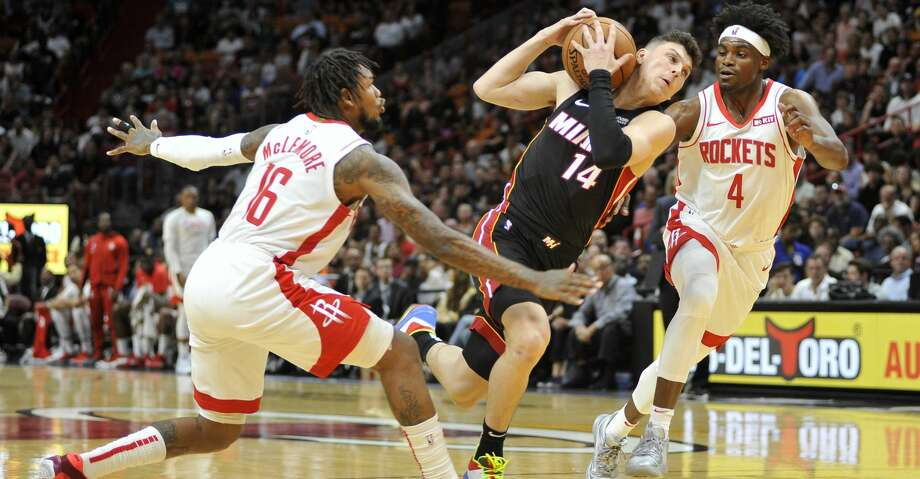 Miami Heat guard Tyler Herro (14) drives to the net against Houston Rockets guard Ben McLemore (16) and forward Danuel House Jr. (4) during the first half of an NBA basketball game, Sunday, Nov. 3, 2019, in Miami. (AP Photo/Gaston De Cardenas) Photo: Gaston De Cardenas/Associated Press