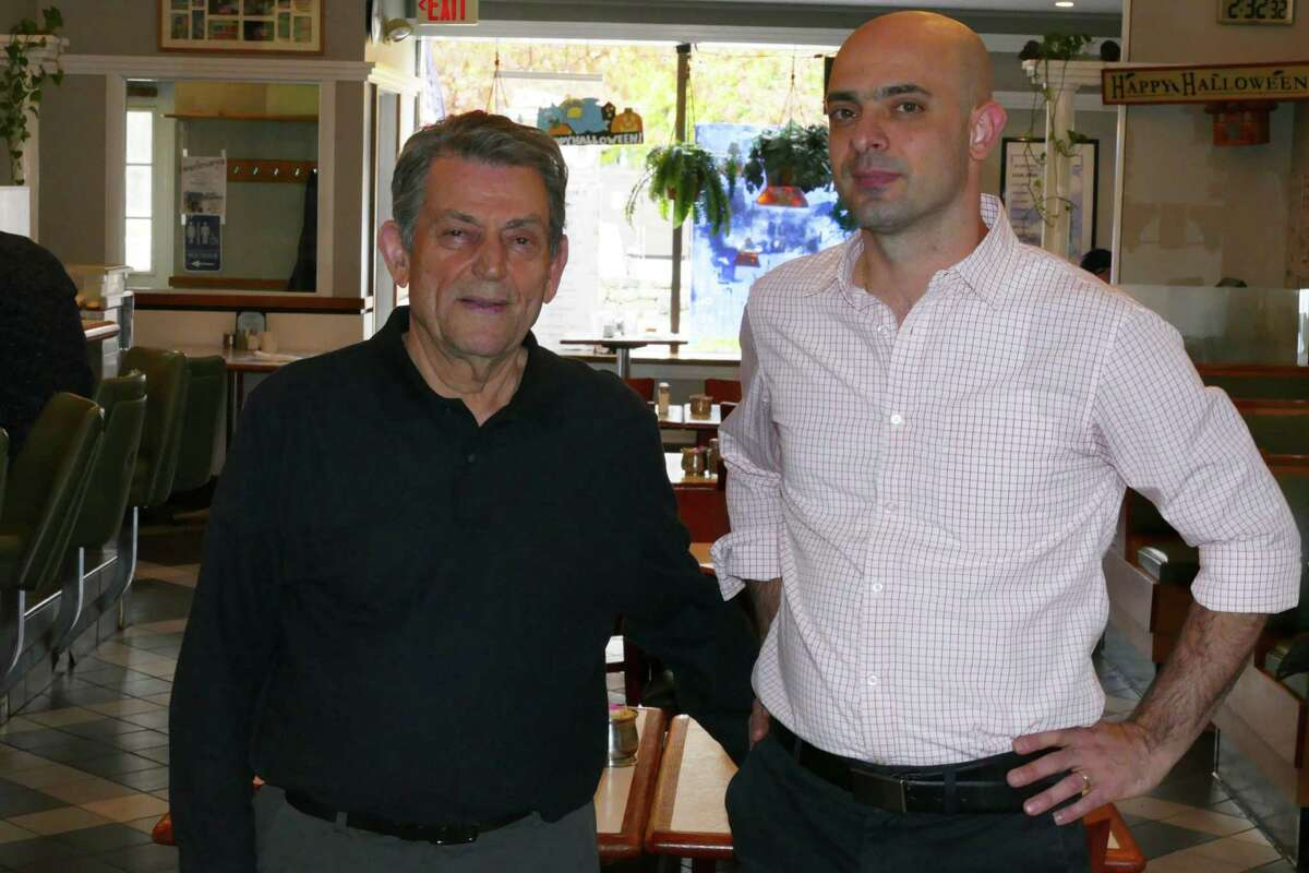 Dimitri's Diner owner Dimitrios Paschalidis, and manager Kostas Mavridis inside the Prospect Street restaurant. Last month, the business celebrated its 25th anniversary.