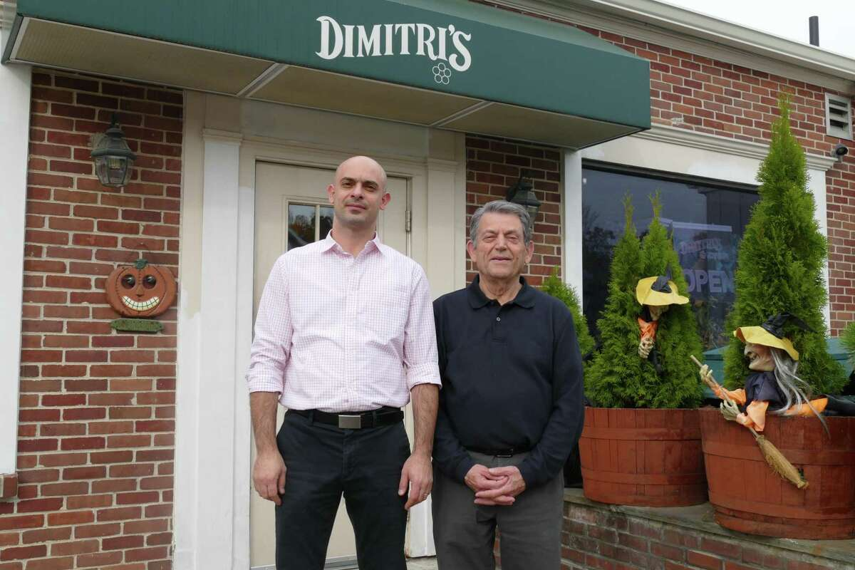 Dimitri's Diner owner Dimitrios Paschalidis, and manager Kostas Mavridis outside the Prospect Street restaurant. Last month, the business celebrated its 25th anniversary.
