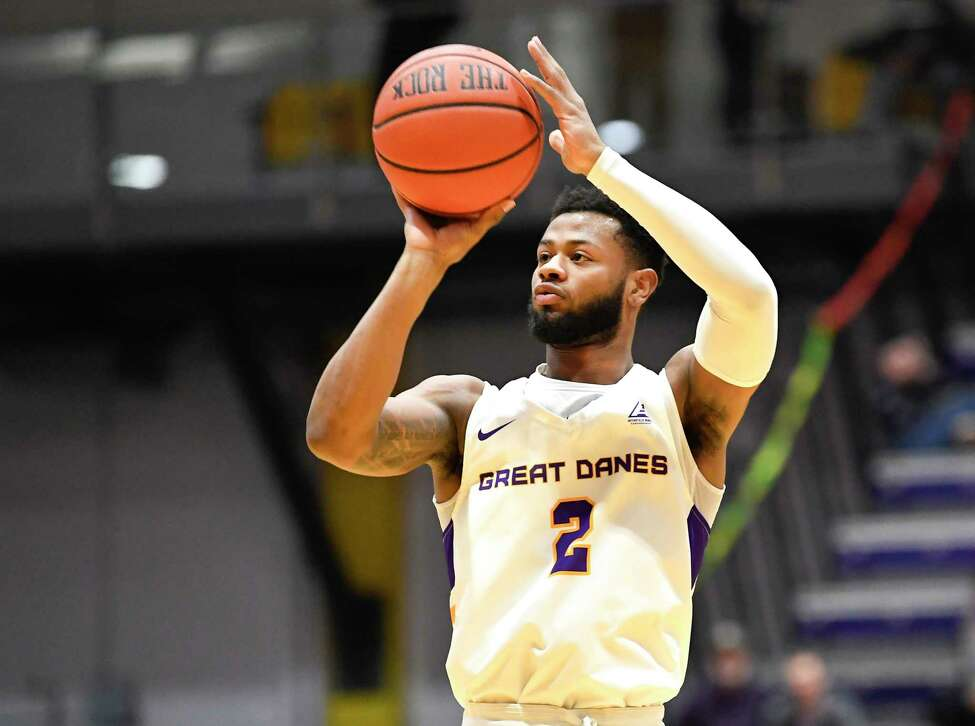 University at Albany guard Ahmad Clark (2) shoots the ball against University of Massachusetts during the first half of an NCAA men's college basketball game Wednesday, Feb. 13, 2019, in Albany, N.Y. (Hans Pennink / Special to the Times Union)