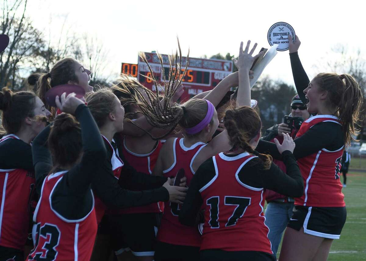 Guilderland field hockey players cheer following the receipt of the Section II Champions plaque for their victory over Shenendehowa in the Class A final in Glens Falls, N.Y. on Sunday, Nov. 3, 2019. (Jenn March, Special to the Times Union)
