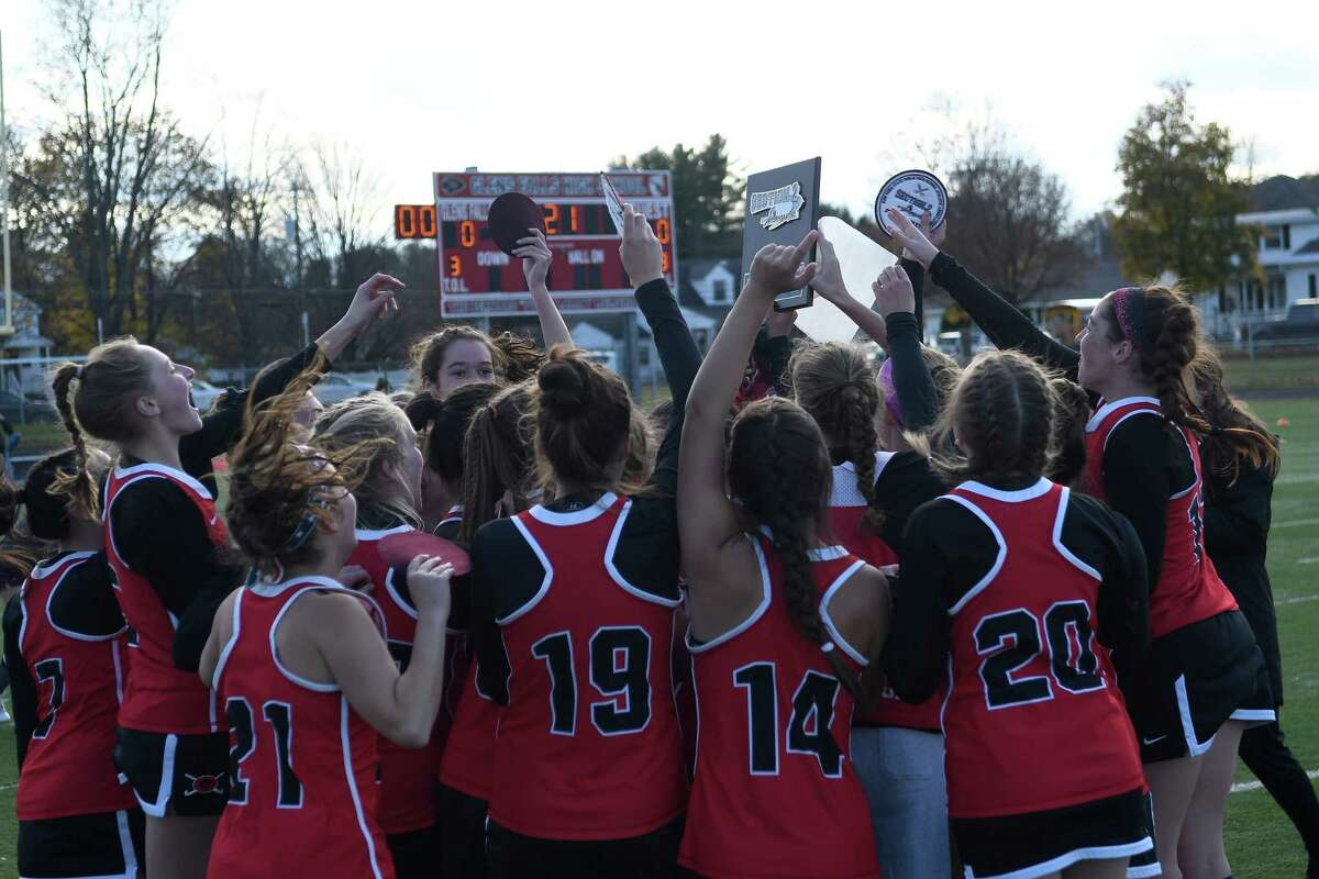 Guilderland field hockey players rally over their Section II Champions plaque following their victory over Shenendehowa in the Class A final in Glens Falls, N.Y. on Sunday, Nov. 3, 2019. (Jenn March, Special to the Times Union)