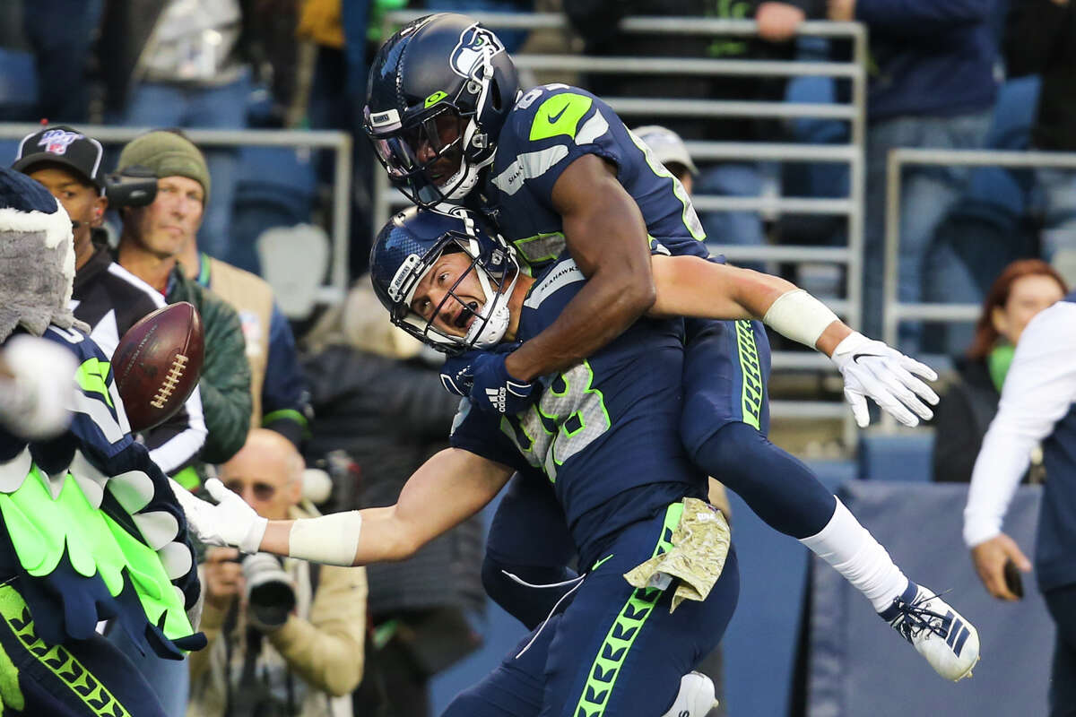 Seattle Seahawks wide receiver David Moore (83) jumps on Seattle Seahawks tight end Jacob Hollister (48) after Hollister scored the game winning touchdownb during overtime in Seattle's game against Tampa Bay, Sunday, Nov. 3, 2019 at CenturyLink Field. The Seahawks won 40-34 in overtime