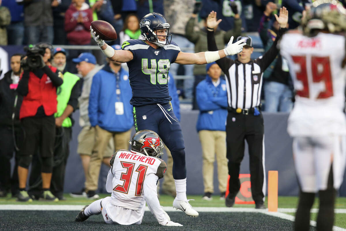 Seattle Seahawks tight end Jacob Hollister (48) scores a game winning touchdown during the overtime period in Seattle's game against Tampa Bay, Sunday, Nov. 3, 2019 at CenturyLink Field. The Seahawks won 40-34 in overtime