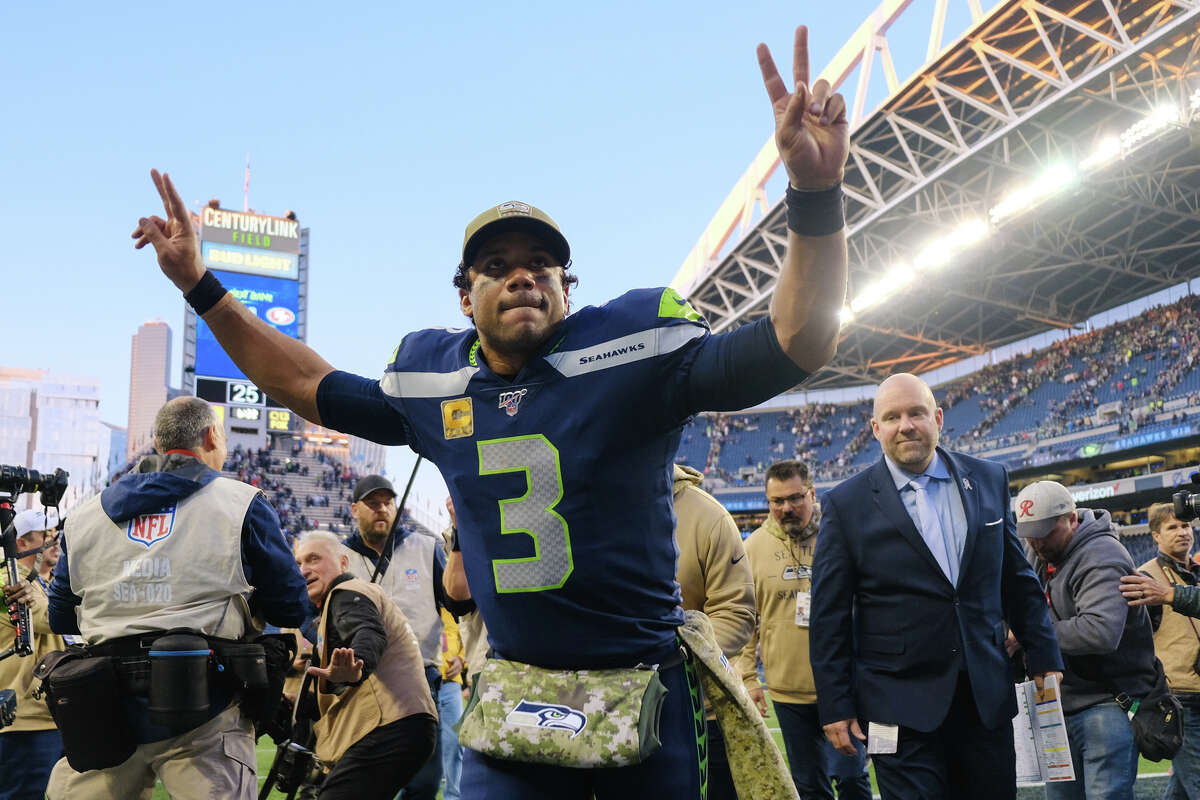 Seattle Seahawks quarterback Russell Wilson (3) gestures to the crowd as he runs off-field after Seattle won their game against Tampa Bay 40-34 in overtime, Sunday, Nov. 3, 2019 at CenturyLink Field.