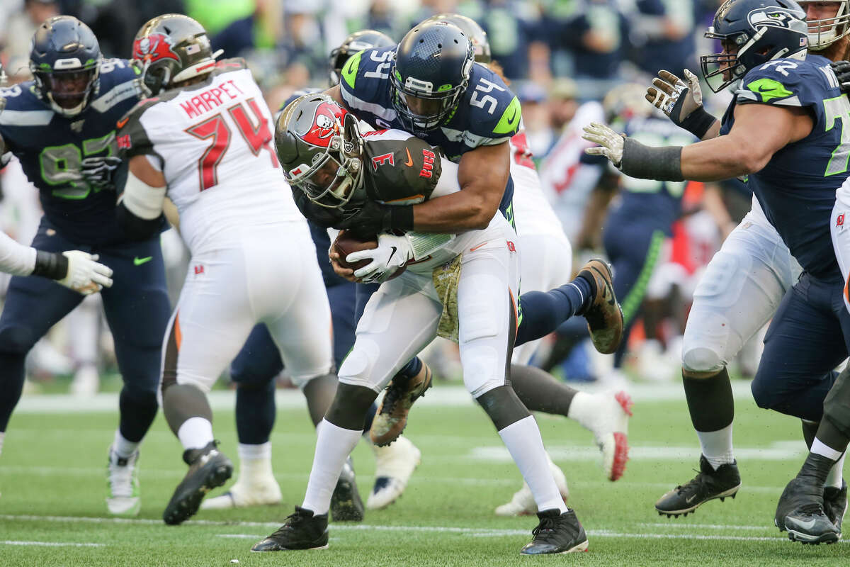 Seattle Seahawks middle linebacker Bobby Wagner (54) sacks Tampa Bay Buccaneers quarterback Jameis Winston (3) in the fourth quarter of Seattle's game against Tampa Bay, Sunday, Nov. 3, 2019 at CenturyLink Field. The Seahawks won 40-34 in overtime.