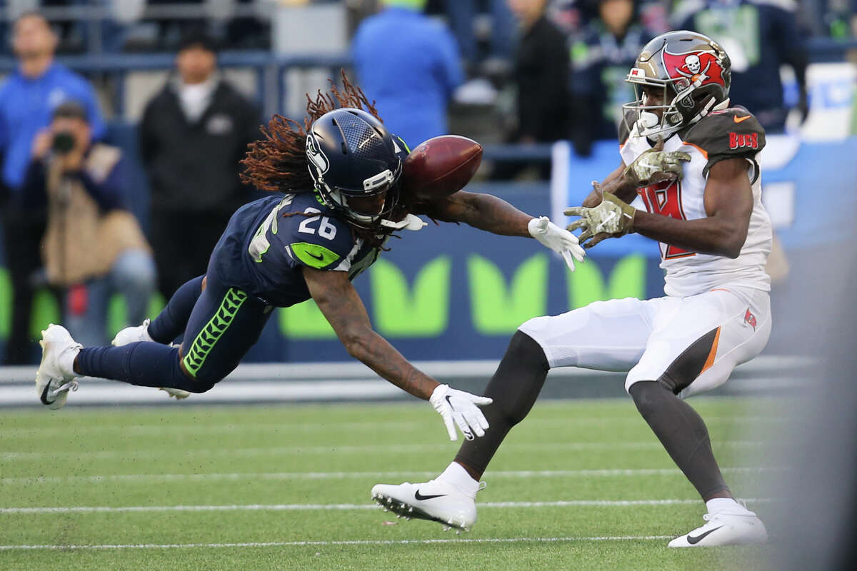 Seattle Seahawks cornerback Shaquill Griffin (26) breaks up a pass to Tampa Bay Buccaneers wide receiver Breshad Perriman (19) in the fourth quarter of Seattle's game against Tampa Bay, Sunday, Nov. 3, 2019 at CenturyLink Field. The Seahawks won 40-34 in overtime.