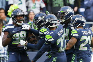 Teammate celebrate with Seattle Seahawks defensive end Rasheem Green (98) after he ran the ball for 36-yards after recovering a fumble by Tampa Bay Buccaneers quarterback Jameis Winston (3) in the fourth quarter of Seattle's game against Tampa Bay, Sunday, Nov. 3, 2019 at CenturyLink Field. The Seahawks won 40-34 in overtime.