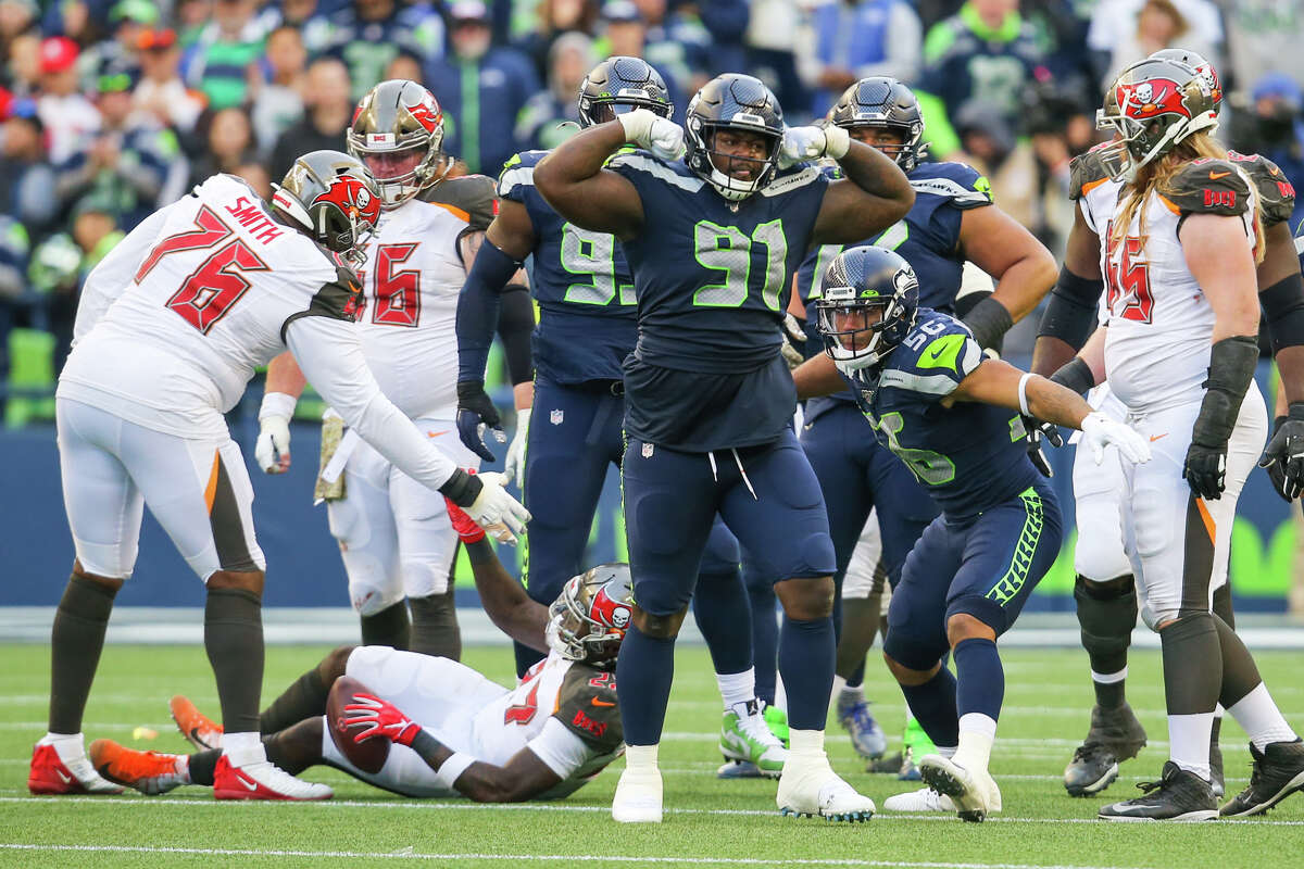Seattle's defensive tackle Jarran Reed celebrates his tackle of Tampa Bay Buccaneers running back Ronald Jones (27) in the fourth quarter of Seattle's game against Tampa Bay, Sunday, Nov. 3, 2019 at CenturyLink Field. The Seahawks won 40-34 in overtime.