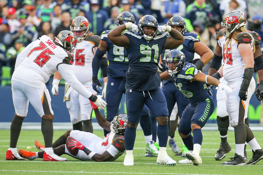 Seattle's defensive tackle Jarran Reed celebrates his tackle of Tampa Bay Buccaneers running back Ronald Jones (27) in the fourth quarter of Seattle's game against Tampa Bay, Sunday, Nov. 3, 2019 at CenturyLink Field. The Seahawks won 40-34 in overtime. Photo: Genna Martin, Seattlepi.com / GENNA MARTIN