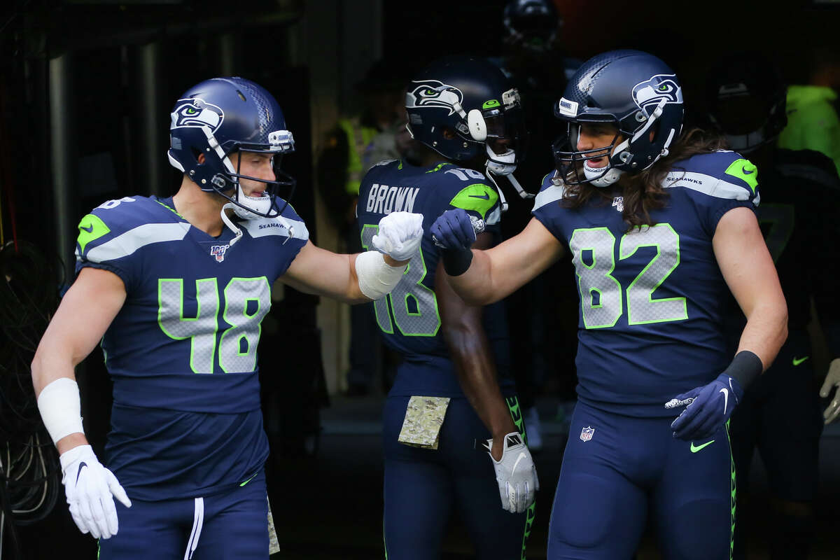 Seattle Seahawks tight end Jacob Hollister (48) and tight end Luke Willson (82) exit the tunnel to warm up before their game against Tampa Bay, Sunday, Nov. 3, 2019 at CenturyLink Field. The Seahawks won 40-34 in overtime.
